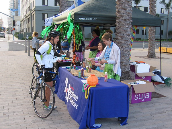 On Harbor Drive at the Broadway Pier, a pit stop included a San Diego Regional Chamber of Commerce table.