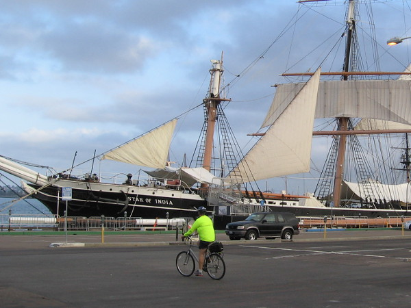 Someone pedals past San Diego's historic tall ship Star of India. Another beautiful morning.