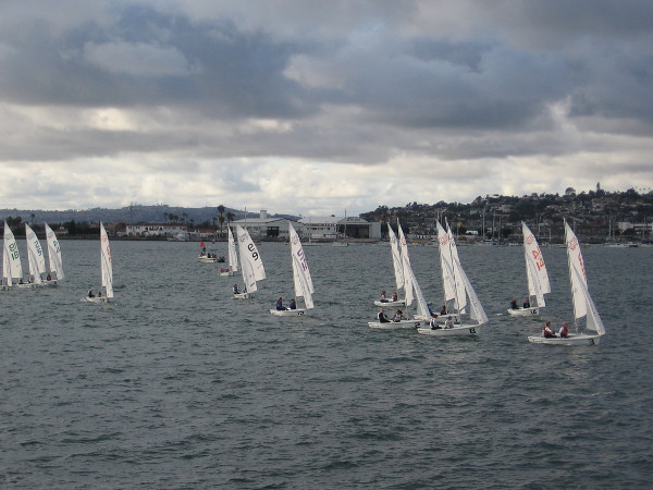The San Diego Yacht Club sailboats approach the Embarcadero, having just passed the finish line.