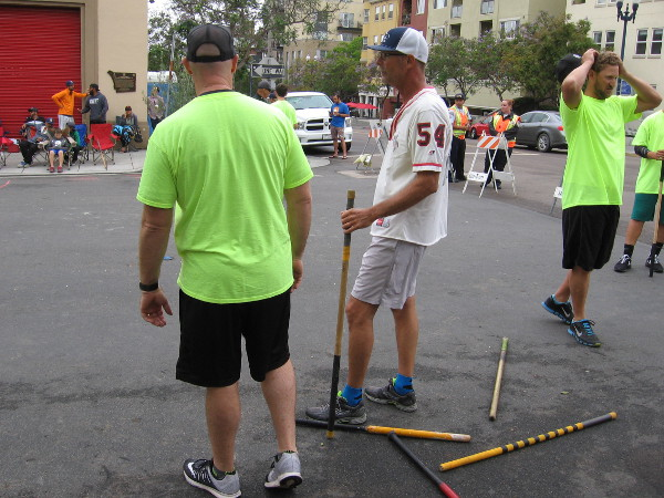 Players prepare to go to bat during a stickball tournament in San Diego's Little Italy.