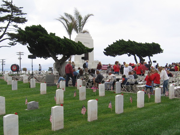 People assemble in front of the rostrum where the Memorial Day service will be conducted at Fort Rosecrans National Cemetery.