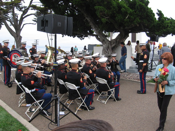 The ceremony is over, and those visiting the cemetery fan out to pay their respects. The Marine Band remained seated for a bit of concluding music.