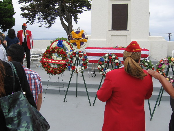 After the Memorial Day ceremony, some people linger to view the ceremonial wreaths. The plaque behind the rostrum contains President Lincoln's famed Gettysburg Address.