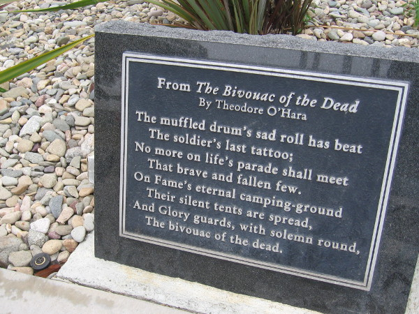 Plaque near Fort Rosecrans National Cemetery entrance has lines from The Bivouac of the Dead, a poem by Theodore O'Hara.