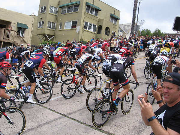 World-class athletes defy gravity as they bicycle up a hill near downtown San Diego during the first stage of the Tour de California.