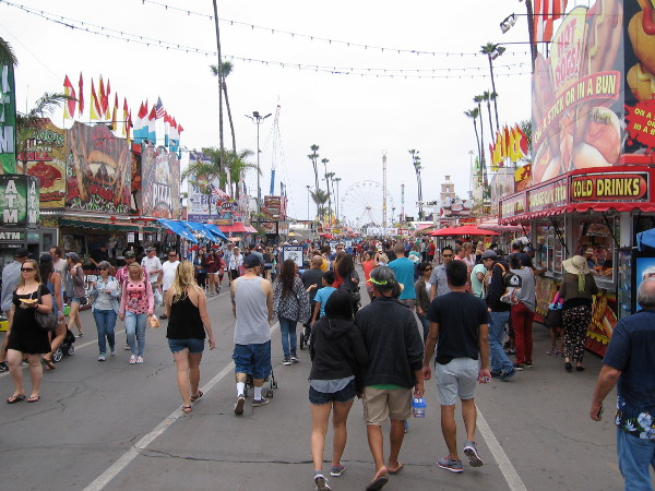 Walking down the good old midway. Once known as the Del Mar Fair, the county fair is a wildly popular summer attraction in Southern California.
