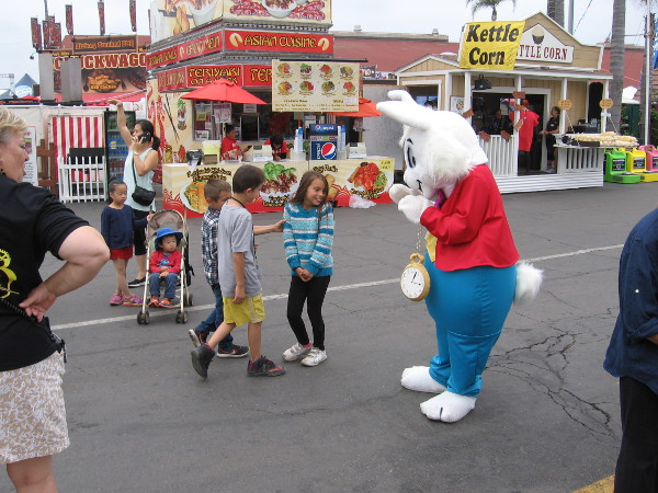 There's a White Rabbit walking along! Don't follow him! You don't know where he might lead!