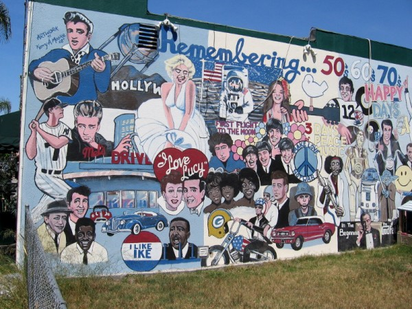 A super cool street mural in North Park depicts icons from three decades: the 50s, 60s and 70s.