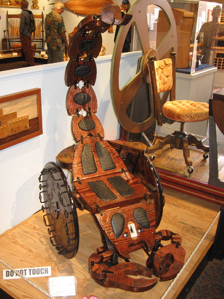 Yikes! Get out of the way! This eye-catching contraption is just too cool. Scorpion Wheelchair, Pine, Roger Aceve.