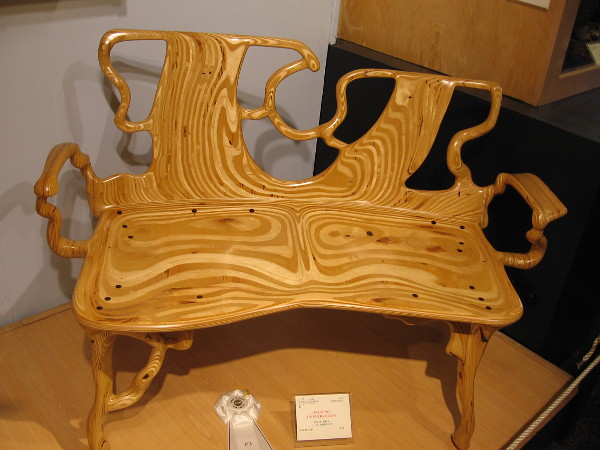 Wood grains flow in this crazy organic bench. Ongoing Conversation, Baltic Birch, Alan Johnson.