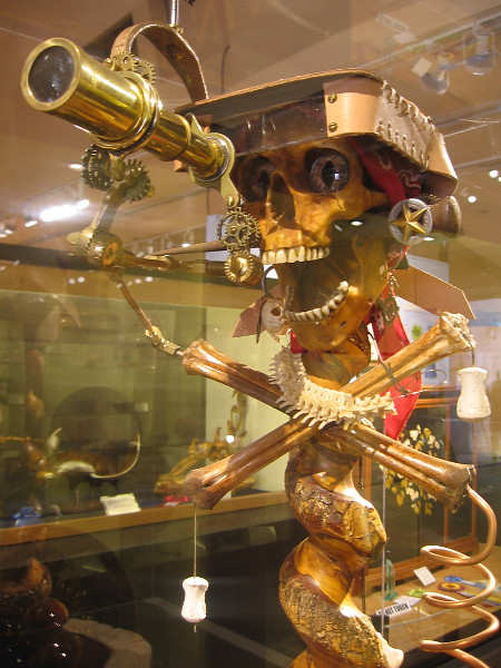 This skeleton pirate with a brass steampunk telescope is beyond awesome. Mutiny, Bloodwood Fir, Mike Anderson.