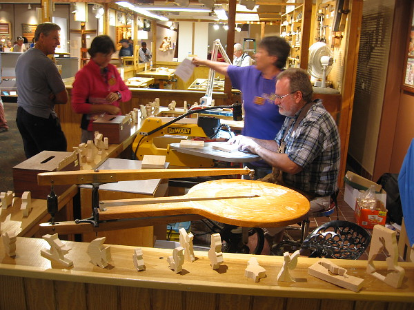 Members of the San Diego Scrollsaw Clubs demonstrate their craft to people visiting the Design in Wood Exhibition at the San Diego County Fair.