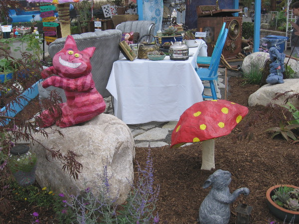 One of many fun displays outside at the Paul Ecke Jr. Garden Show. I see the grinning Cheshire Cat and all sorts of other Alice and Wonderland stuff.