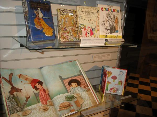 One display highlights differently illustrated Alice's Adventures in Wonderland books over the years. Some are imaginative adaptions or interpretations.