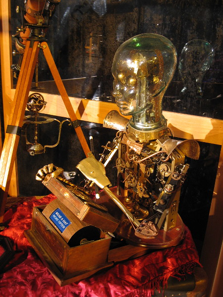 A very cool steampunk mechanical man made of brass gears, with a glass globe for its head.