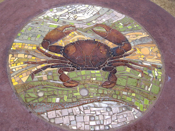 A crab is featured in this colorful mosaic of ceramic tiles.