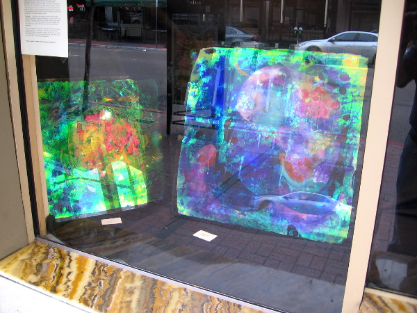 More examples of Liguori's dazzling, thought-provoking pieces. Apparently the application of his special holographic paint on glass is an entirely new, revolutionary art form.