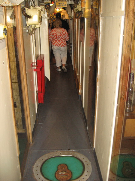 Heading through the Foxtrot-class Soviet submarine. Tiny rooms on either side include the Captain's Cabin, the Officer's Wardroom, and Medical Exam Room.