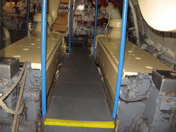 The engine room contains three turbo diesel engines that each put out 2000 horsepower. They drove three shafts connected to six-blade propellers.