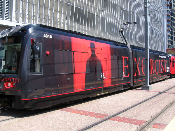 The Exorcist appears on one side of a San Diego trolley. This enormous moving ad for the new FOX show will be seen by thousands of pop culture fans attending Comic-Con next month. Today it's operating on the Green Line, which goes right past the convention center!