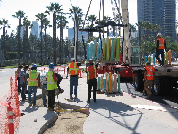 The artists supervise the installation of their monumental art. It will be finished just in time for San Diego Comic-Con next month.