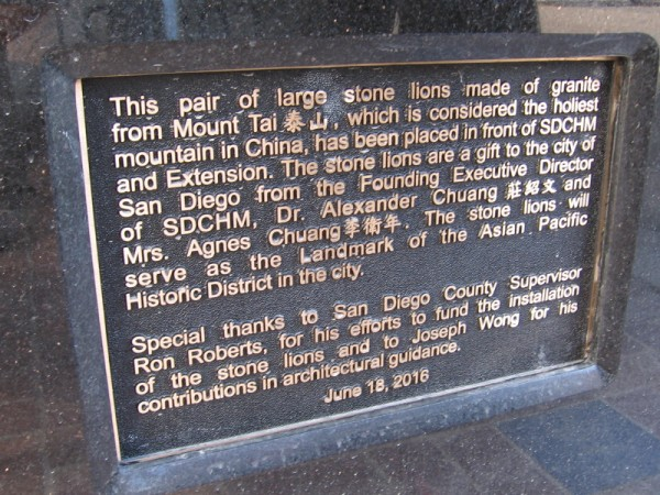 Plaque describes pair of large stone lions made of granite from Mount Tai, considered the holiest mountain in China. They will be a landmark of the Asian Pacific Historic District of San Diego.