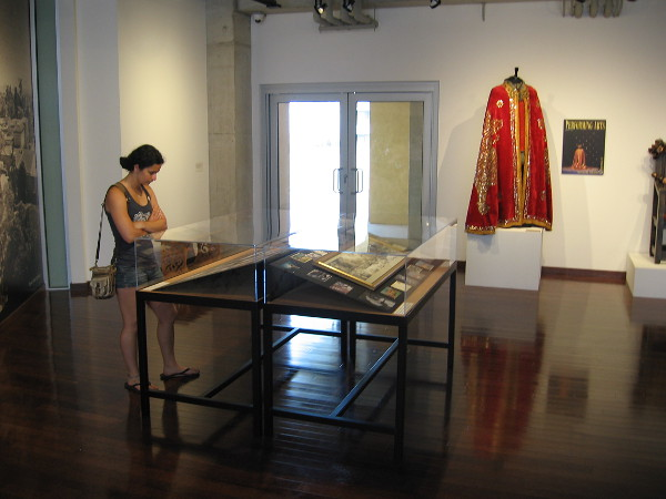 Visitor to First Folio special exhibit examines photos from the history of the Old Globe, one of the leading Shakespeare theatres in the United States. The cloak is from a production of Henry IV, Part 1.