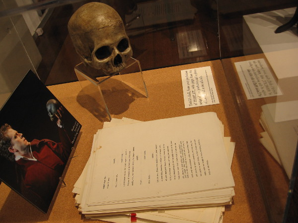 Yorick's skull, with pages from a Hamlet script and photo of Lucas Hall in the title role.