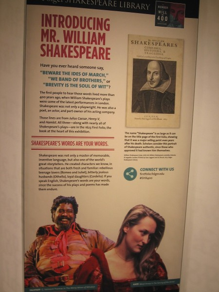 On either side of the displayed First Folio are several signs. The first one pictured introduces Shakespeare. His words are your words.