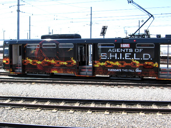 Another older model San Diego trolley car has been wrapped with the new Agents of S.H.I.E.L.D. graphics, for the upcoming 2016 Comic-Con. I've seen several of these cars in the past few days!