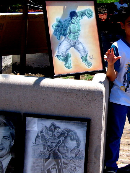 Even the street artists are getting ready. A kid was having fun posing by this Incredible Hulk art!