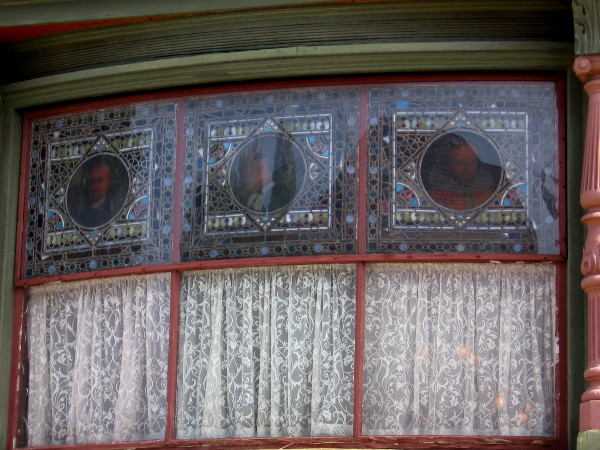 Unusual curved bay window of the drawing room features stained glass images of Shakespeare, Goethe and Corneille.