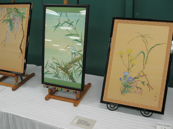 According to a nearby sign, this Nihonga Japanese Style painting uses gansai Japanese colors on gold screen or dosa treated rice paper or on silk.