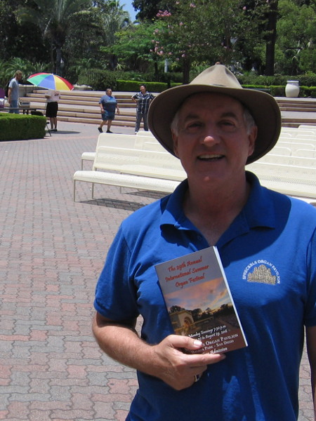 Ross Porter, Executive Administrator of the Spreckels Organ Society, shows us the newly printed program which visitors will receive at every free summer Monday night performance.