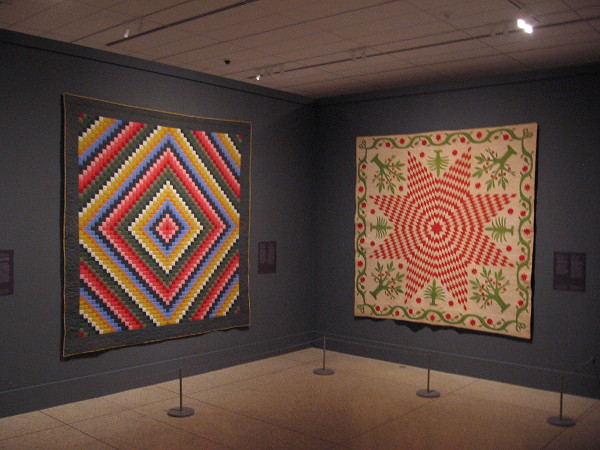 Amazing early American quilts on display at the San Diego Museum of Art feature beautifully contrasted colors and abstract designs.