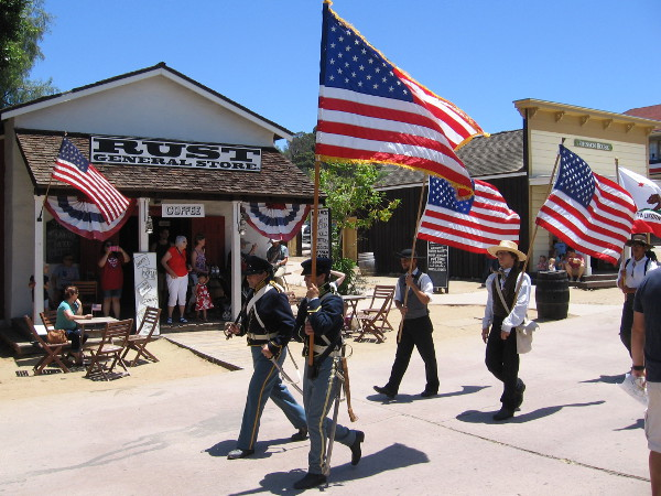 American flags lead a Fourth of July parade in Old Town San Diego State Historic Park.