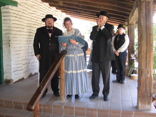 Los Bailadores, performers in period costume, sing vintage patriotic songs like The Battle Hymn of the Republic inside Old Town's historic La Casa de Estudillo.