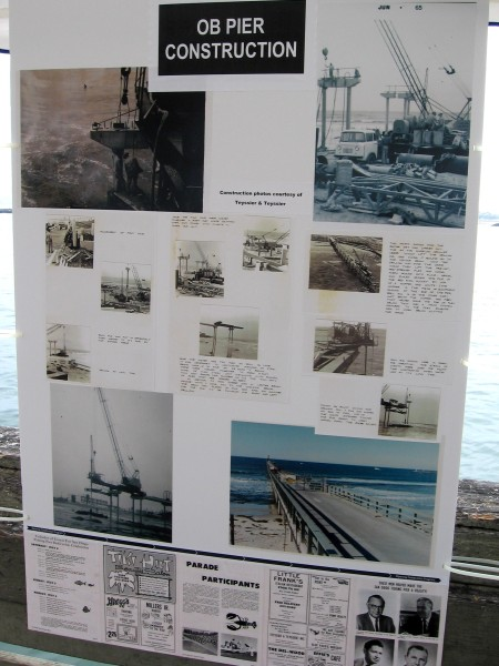 Poster shows photos of the OB Pier construction back in the 1960s. 2 foot diameter piles were place 12 feet deep into bedrock. Slabs placed on top were welded securely.