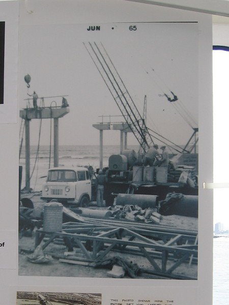 Photo shows concrete pilings and steel. The pier has survived countless huge storms over the decades.