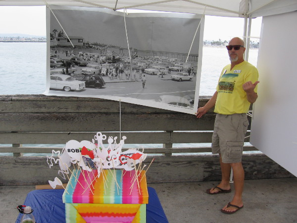This cool dude gave me the thumbs up while hanging a display for the OB Pier's 50th anniversary. That's Ocean Beach style!