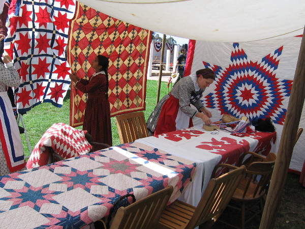 Quilters were getting their tent displays ready as Old Town San Diego's Fourth of July events got underway.