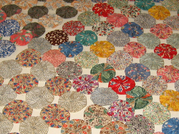 Some colorful fabric circles arranged on a table.