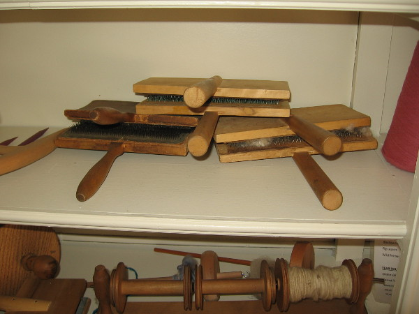 Several hand carders. Carding is gently spreading washed and dried wool in preparation for future processing, like spinning.