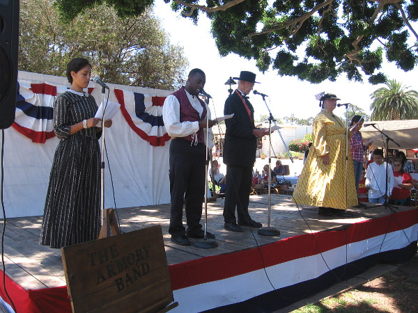 Diverse folk representing San Diego in the mid 19th century take turns reading the Declaration of Independence. Ordinary citizens in the crowd also took part!