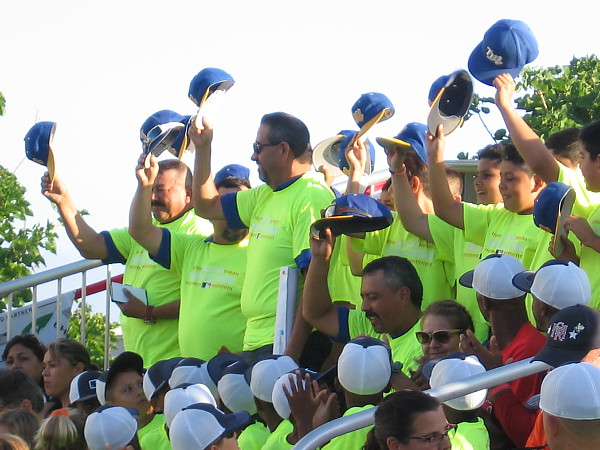 One of the teams from Tijuana, Mexico salutes the crowd by removing their caps.