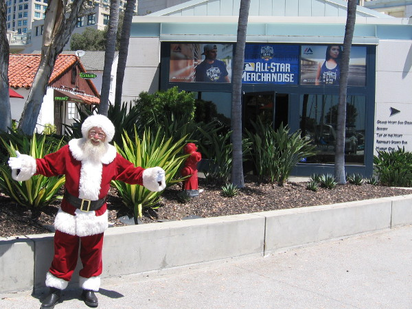 Yesterday, Santa was hanging out by a Seaport Village sign that advertises All-Star Game merchandise. He told me he was there to spread smiles. Sounds good to me!
