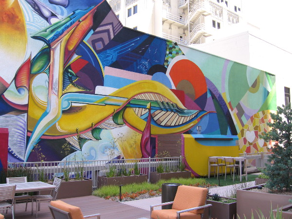 Photo of central portion of the dynamic artwork. Unusual forms and bold colors lead the delighted eye around this little-seen urban canvas.