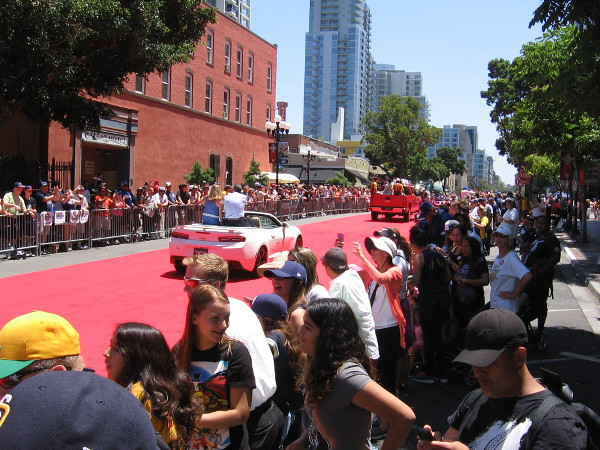 The first couple vehicles in the parade have passed. I've taken position next to the red carpet in San Diego's historic Gaslamp Quarter.