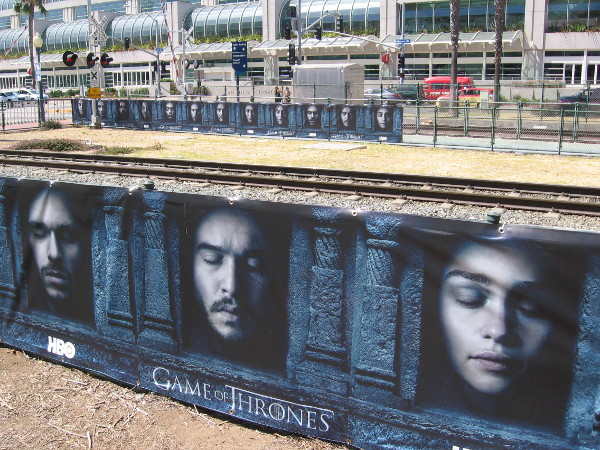 Several banners along the trolley tracks promote the newest season of Game of Thrones.