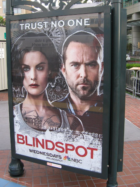 Poster at the Gaslamp trolley station advertises Blindspot. Trust no one.